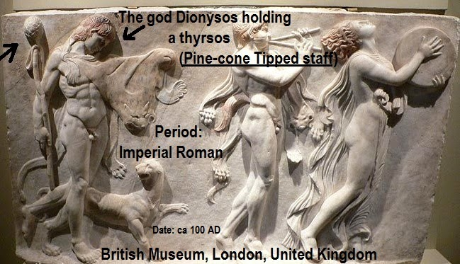 The god Dionysos holding a thyrsos (pine-cone tipped staff)